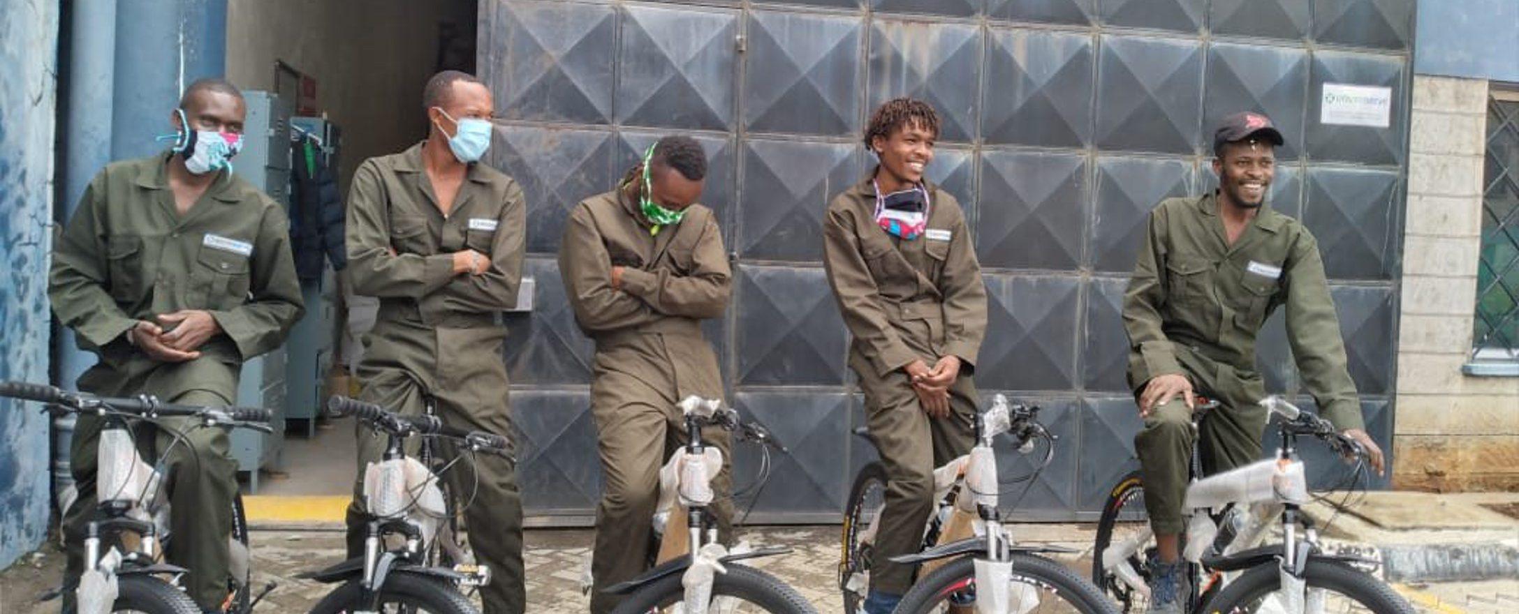 Enviroserve Kenya warehouse team with their new bikes